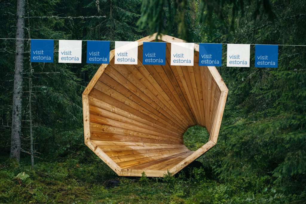 Visit Estonia flags in a forest