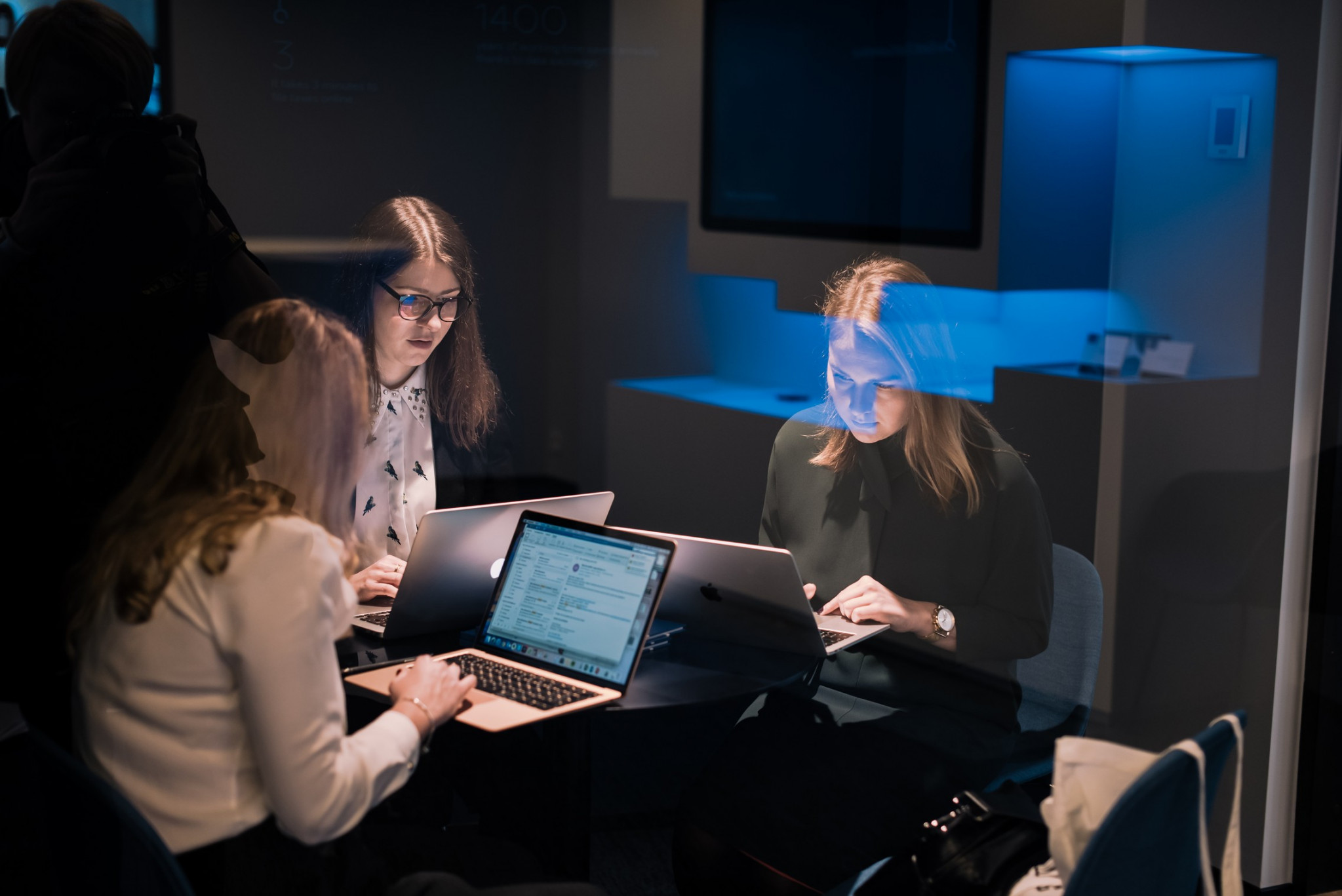 Group of woman working on computers